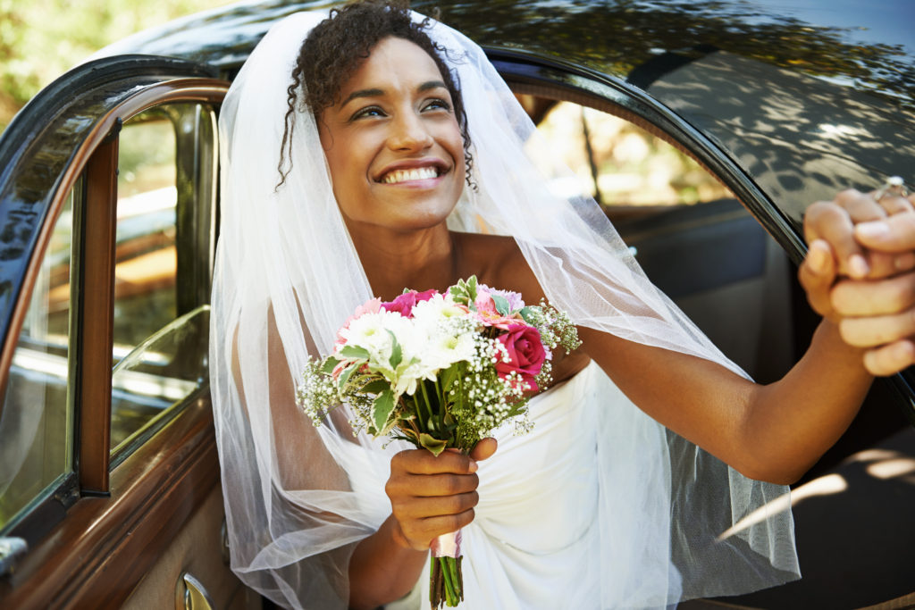 Shot of a beautiful young bride being helped out of the wedding carhttp://195.154.178.81/DATA/i_collage/pu/shoots/784347.jpg